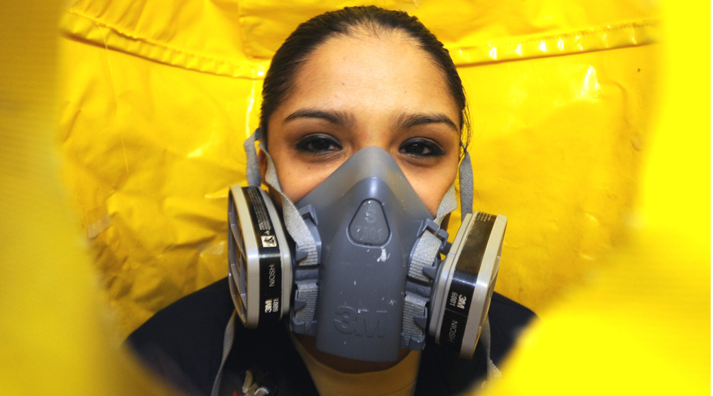 101013-N-5361G-080  ARABIAN SEA (Oct. 13, 2010) Logistics Specialist 2nd Class Jessica Gonzales, from San Antonio, performs a fit test on a P100 respirator to ensure a proper seal aboard the aircraft carrier USS Harry S. Truman (CVN 75). The Harry S. Truman Carrier Strike Group is deployed supporting maritime security operations and theater security cooperation efforts in the U.S. 5th Fleet area of responsibility. (U.S. Navy photo by Mass Communication Specialist 3rd Class David Giorda/Released)